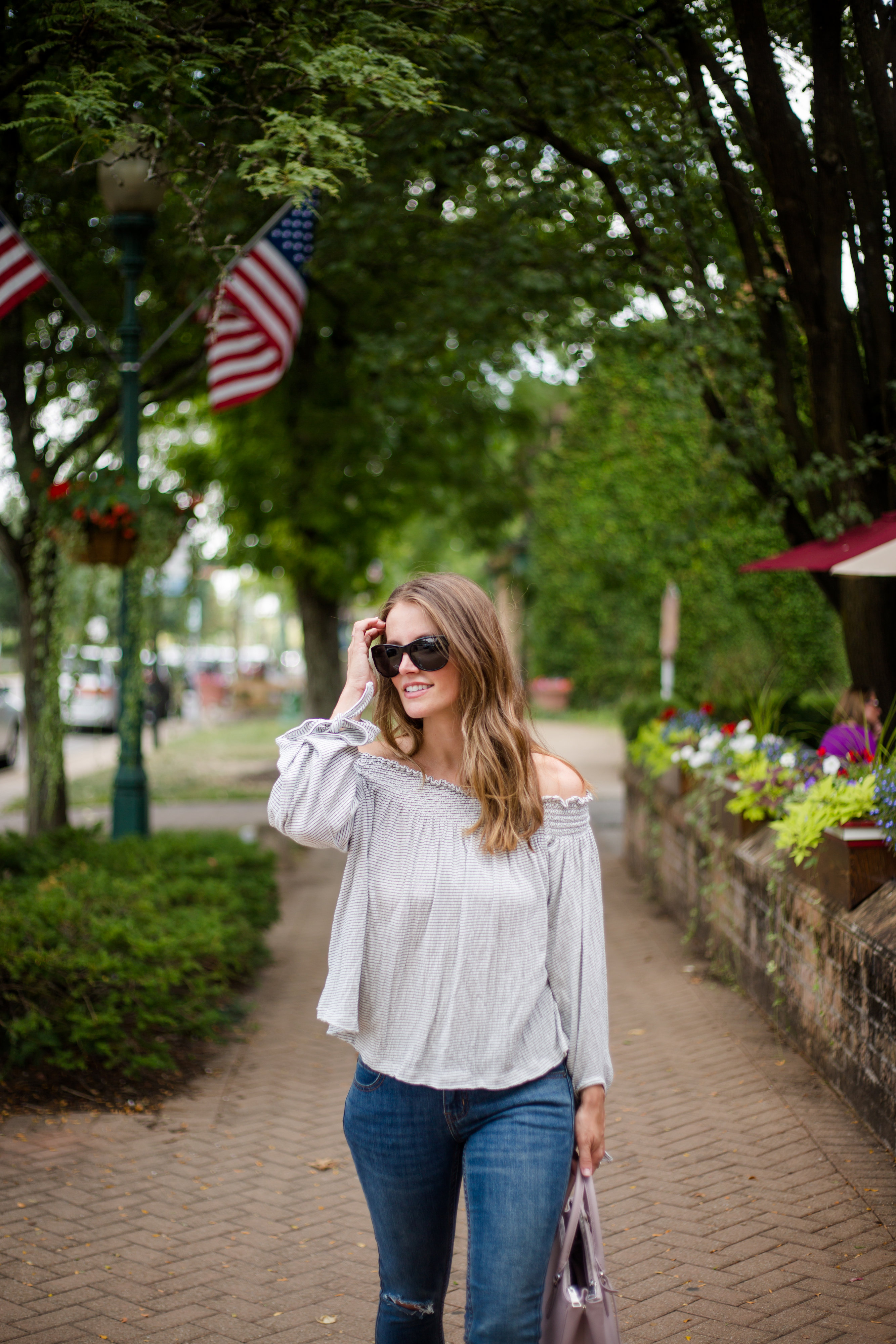 free people off the shoulder shirt raw hem jeans fall outfit